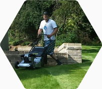 Lee Fairweather mowing a lawn